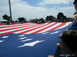1812 reenactors flag unfurling - Julie Moser